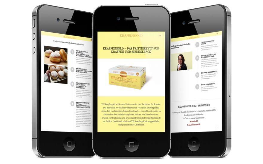 Kundenprojekt Krapfengold Webseite am iPhone, die Seite ist übersichtlich realisiert und Kunden könenn auf jedem Endgerät Informationen abrufen.